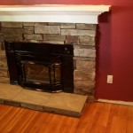 Fireplace stone work and hardwood flooring